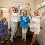 What a celebration! The ladies jump for joy.